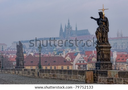 View of Charles Bridge in Prague (Karl?v Most) the Czech Republic. early morning with mist. This bridge is the oldest in the city and a very popular tourist attraction. - stock photo