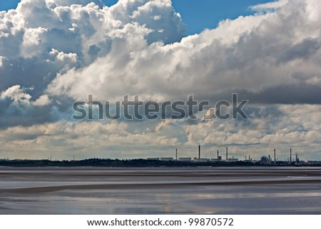 View of chemical plant across river estuary 6 - stock photo