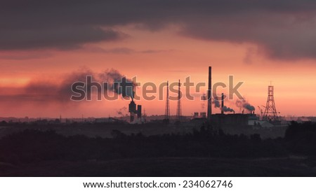 View of chemical plant over the sunset - stock photo