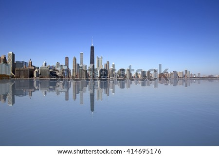 View of Chicago with reflection on the water - stock photo