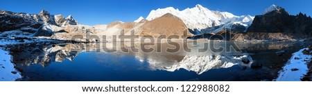 view of Cho Oyu mirroring in lake - Cho Oyu base camp - Everest trek - Nepal - stock photo