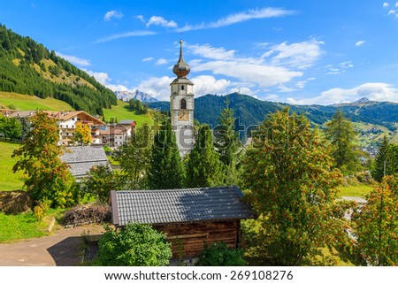 View of church in Colfosco alpine village in Dolomites Mountains, Italy - stock photo