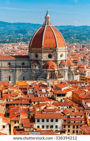 View of city rooftops and Duomo Santa Maria Del Fiore at morning from Palazzo Vecchio in Florence, Tuscany, Italy - stock photo