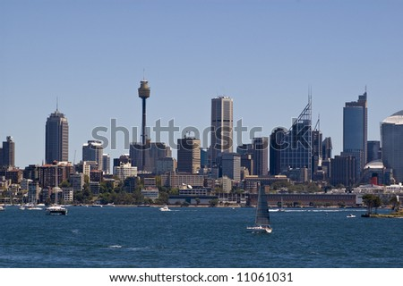view of city skyline from sydney harbor australia with boats in the foreground
