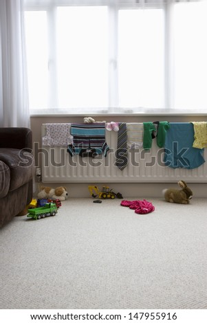 View of clothes drying on radiator at home - stock photo