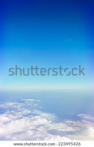 view of clouds and blue sky from high mountain - stock photo