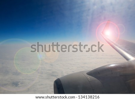 View of clouds from a airplane window. - stock photo