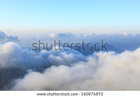 view of clouds from high mountain - stock photo
