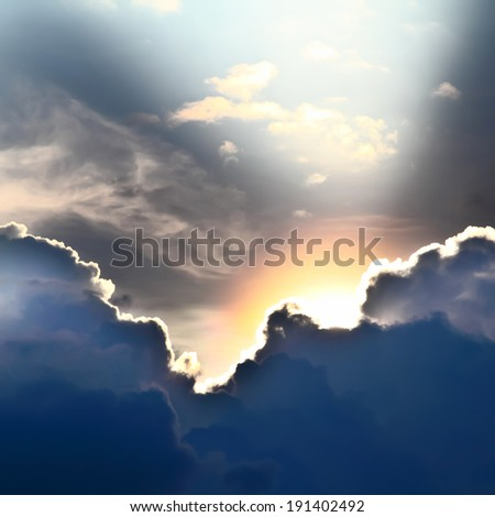 View of clouds in sky with rays of light - stock photo
