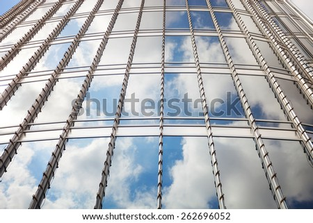 View of clouds reflected the glass surface of Burj Khalifa, Dubai, the tallest tower in the world - stock photo