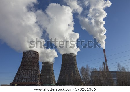 View of coal power plant against blue sky - stock photo