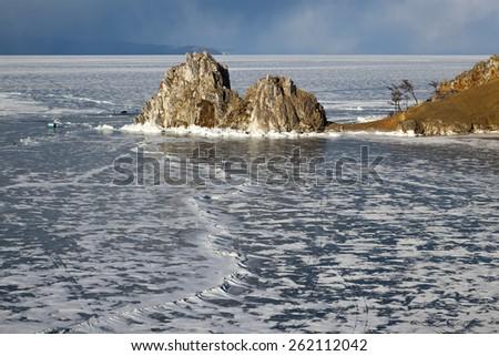 View of coast of Baikal lake, Shaman rock and cape Burhan on Olkhon Island, Russia - stock photo