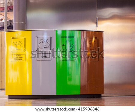View of colorful recycling and garbage bins - stock photo