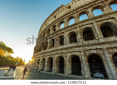 View of Colosseum at sunrise in Rome, Italy.