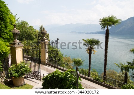 view of Como lake, italian landscape inside Villa Carlotta, located in Tremezzo  famous both for   collections of art preserved within it, both for the extensive botanical gardens.