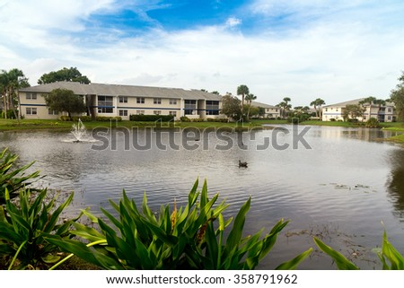 View of condominium area in Florida with a pond - stock photo