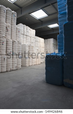 View of cotton stacked in spinning factory - stock photo