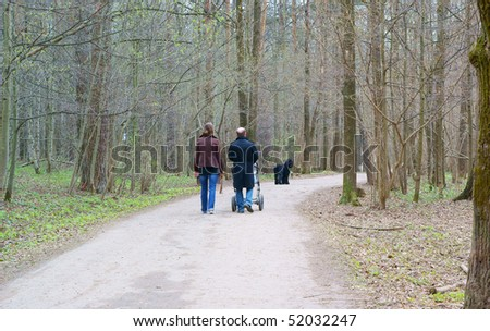View of couple a back walking down the park in spring - stock photo