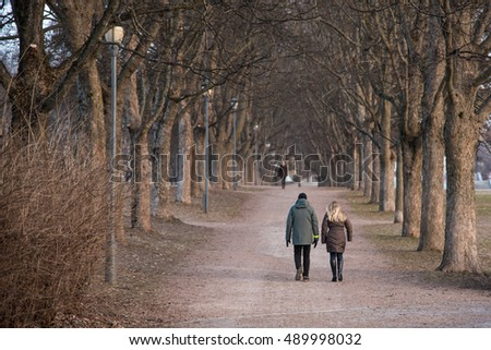 View of couple a back walking in the park at Oslo, Norway
