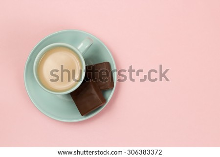 View of Cup of Coffee on a Pink Background - stock photo