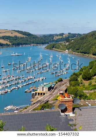 View of Dart river with boats and yachts by Kingswear and Dartmouth blue sky on summer day - stock photo
