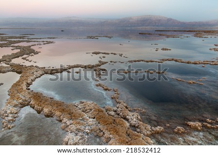 View of Dead Sea coastline at sunset time  - stock photo