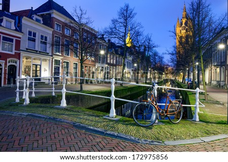 View of Delft at twilight, a city renowned for its historic town center with canals and its association with the Dutch royal family, the House of Orange-Nassau. - stock photo