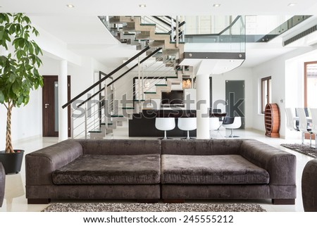 View of designed sofa in expensive house - stock photo