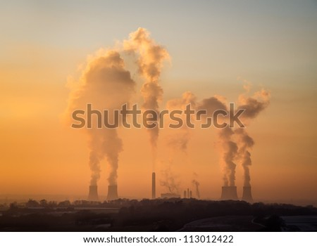 View of Didcot power station cooling towers steam at sunset