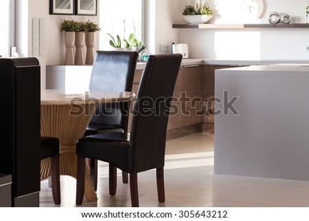 View of dining hall with wooden round table - stock photo