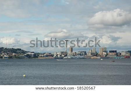 View of downtown and space needle taken from Alki beach. - stock photo