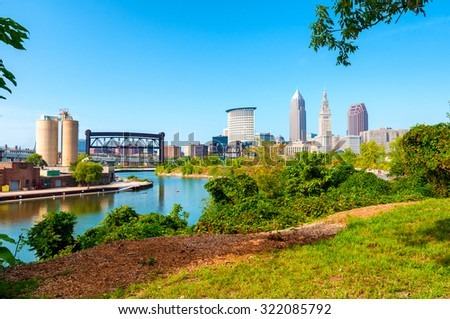 View of downtown Cleveland, Ohio, and the Cuyahoga River from a park on the west bank of the river - stock photo