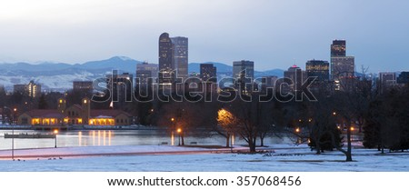 View of downtown Denver at night the lake and geese in the foreground, Colorado, USA