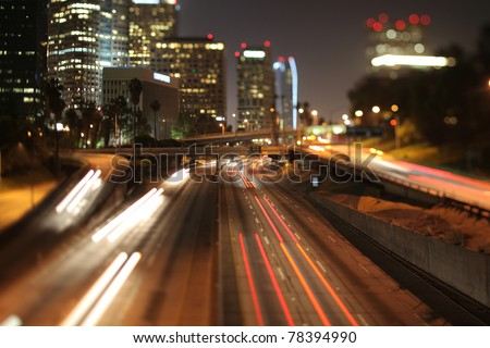 view of downtown los angeles and freeways at night with a tilt shift lens - stock photo
