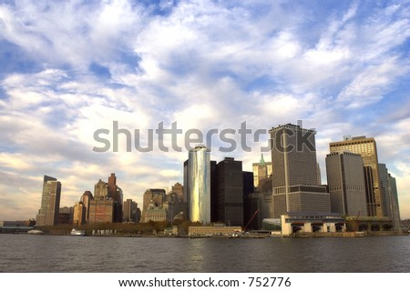 view of downtown manhattan at dusk from the Staten island ferry, Statten island ferry terminal is at the bottom right, new york, America, usa
