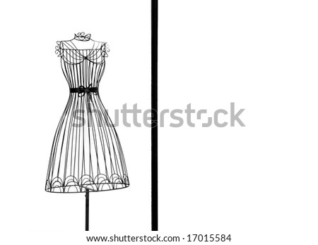 View of dress frame at shop window. - stock photo