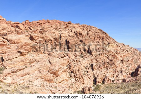 View of dry landscape and red rock formations of the Red Rock Canyon in the Mojave Desert. - stock photo
