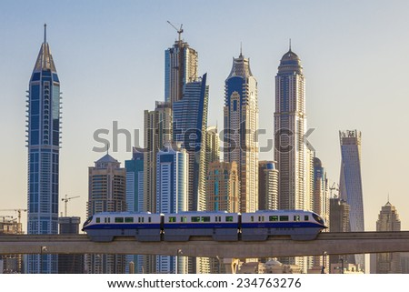 View of Dubai with subway and skyscrapers. - stock photo