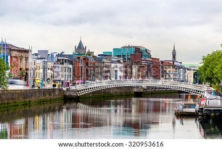 View of Dublin with the Ha'penny Bridge - Ireland - stock photo