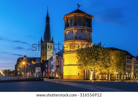 view of Dusseldorf historic center with Old Castle Tower and st Lambertus church in evening, Germany