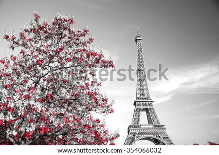 View of Eiffel tower in monochrome style with selective colorization - stock photo