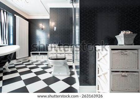 View of elegant, black and white bathroom - stock photo
