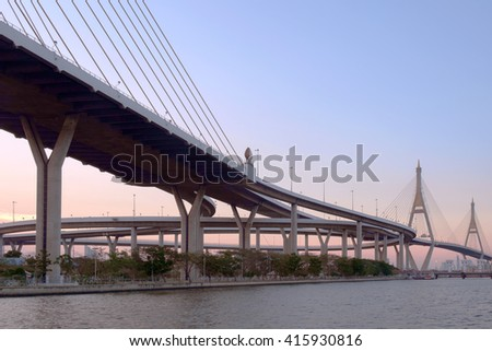 View of elevated expressway cross the river at twilight. - stock photo