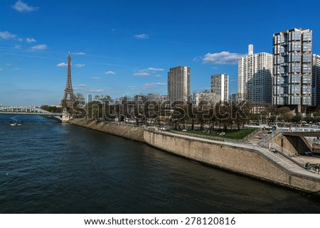 View of embankment of river Seine with Eiffel Tower (La Tour Eiffel). Paris, France. Eiffel Tower, named after engineer Gustave Eiffel, is tallest structure in Paris and most visited monument in world
