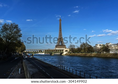View of embankment of river Seine with Eiffel Tower (La Tour Eiffel). Paris, France. Eiffel Tower, named after engineer Gustave Eiffel, is tallest structure in Paris and most visited monument in world - stock photo