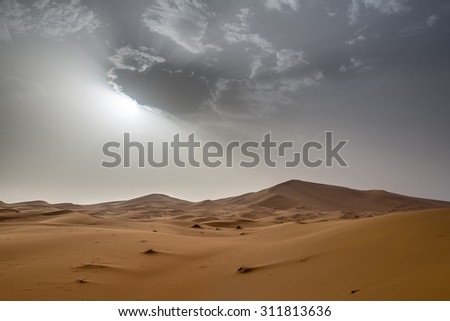 view of Erg Chebbi Dunes in Morocco-  Sahara Desert - during sand storm - stock photo