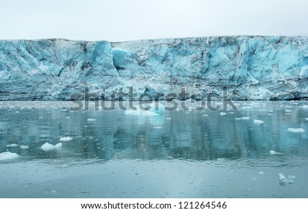 View of Esmark's glacier reflected at calm water in Istfjorden, Spitsbergen (Svalbard island, Norway), Greenland Sea - stock photo