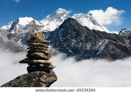 view of everest with stone man from gokyo ri - stock photo