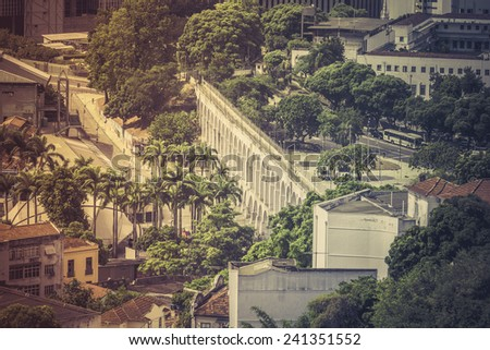 View of famous aqueduct arches in Downtown Rio de Janeiro, Brazil - stock photo