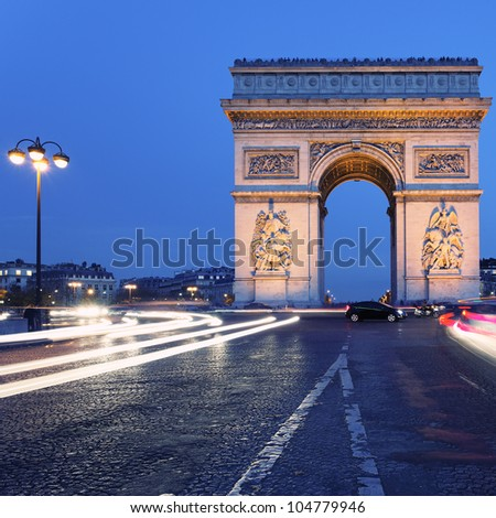 view of  famous Arc de Triomphe by night, Paris - stock photo